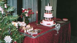 [The cake table, decorated with wedding 	colors]