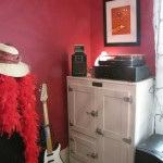 An antique icebox stores items and holds my turntable. The print on the wall is by Rob Morgan.