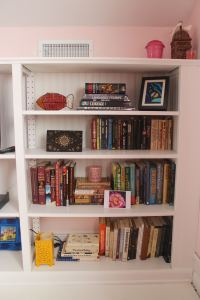 One final look at the bookcase, transformed with paint, trim, and beadboard.