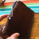 The loop with the beads can be tightened to hold refills inside the notebook.