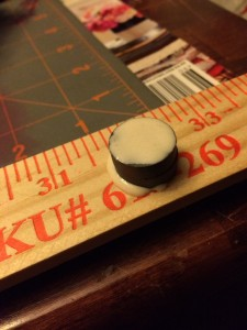 Put wood glue on top of the stack of magnets.