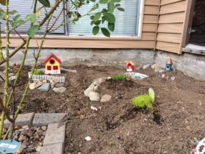 Think about the space you have available and what you might want to fit there. This was one of the earliest stages of my garden: I built some tiny hills and rockeries and planned where some of the houses might go.